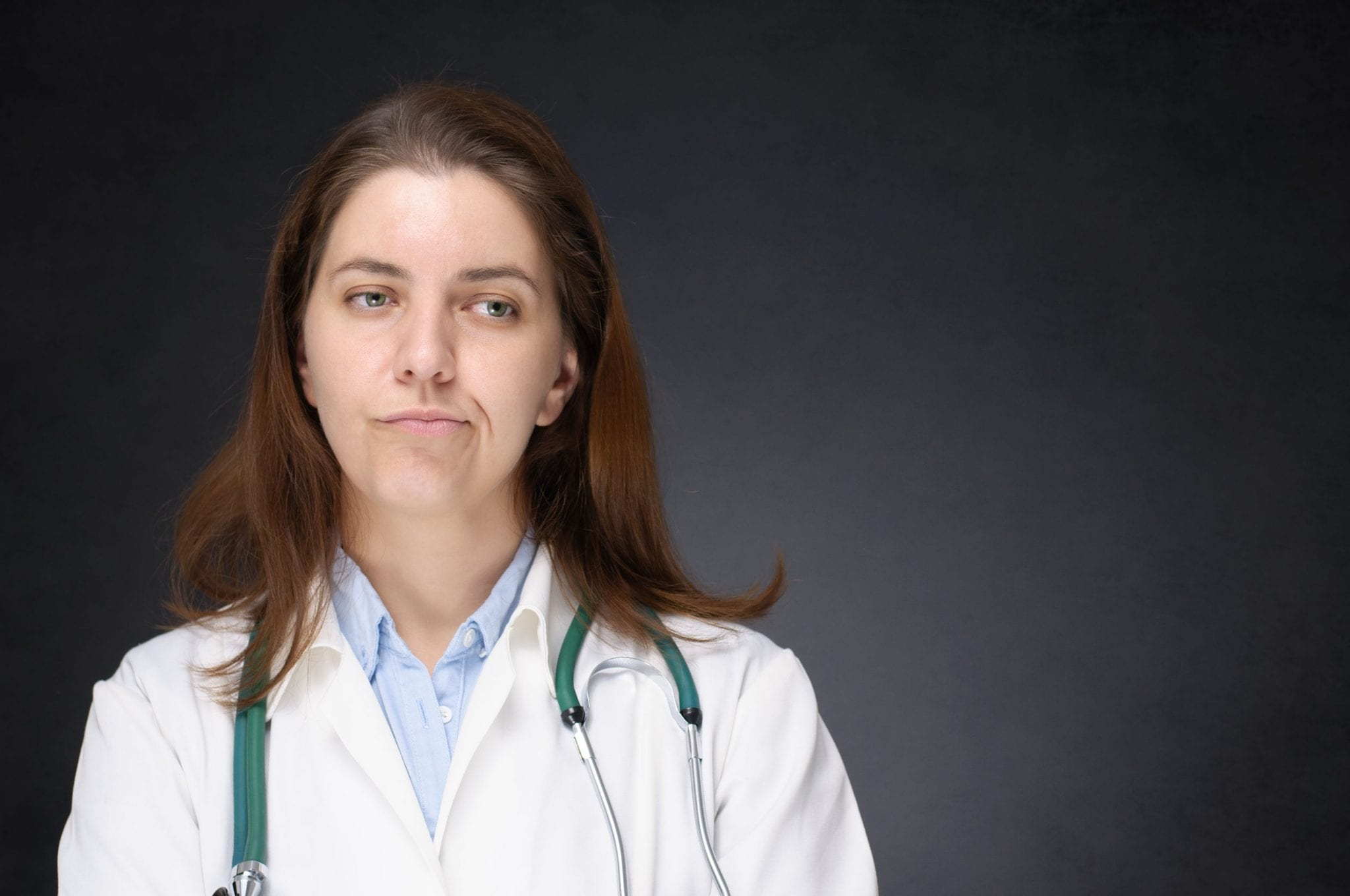 Portrait of a bored, disappointed female doctor